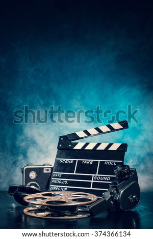 Retro film production accessories still life. Concept of film-making. Smoke effect on background - stock photo