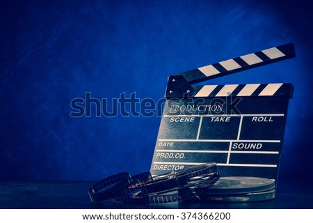 Retro film production accessories still life. Concept of film-making. Smoke effect on background