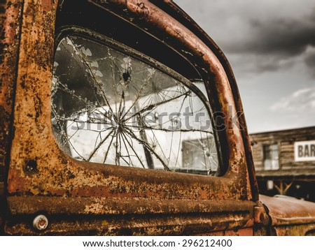 Retro Filtered Americana Image Of A Vintage Rusty Truck Outside A Bar - stock photo