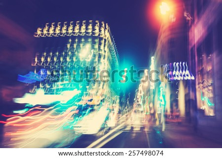 Retro filtered city traffic lights motion blurred. - stock photo