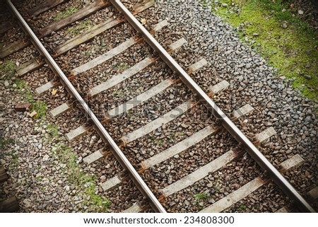 Retro filtered photo of railway tracks background. - stock photo