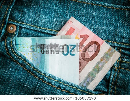 Retro Filtered Style Euro Money In Jeans POcket - stock photo