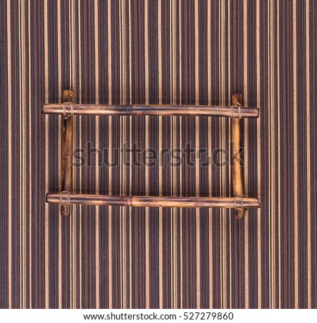 retro frame of bamboo on a white wooden background
