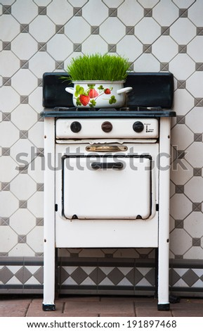 Retro gas stove, kitchen decoration - stock photo