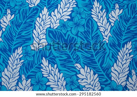 Retro ginger pattern of white flowers and blue leaves against a faded turquoise background. - stock photo