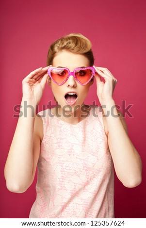 Retro girl with heart sunglasses. Valentine's day concept - stock photo