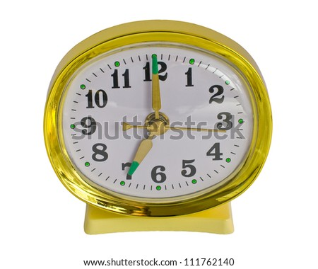 Retro gold alarm clock isolated against a white background - stock photo
