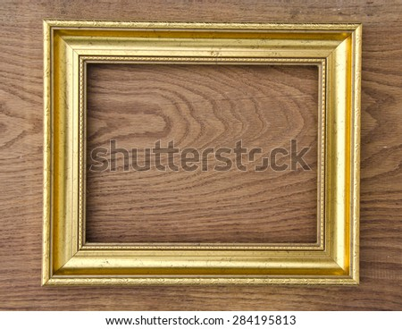 retro golden picture frame on oak wood plank background