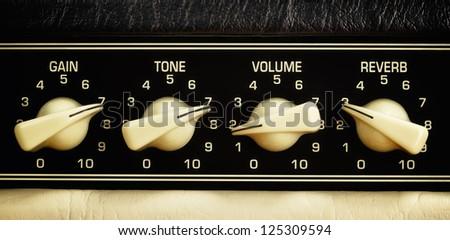 retro guitar amplifier control panel, close up - stock photo