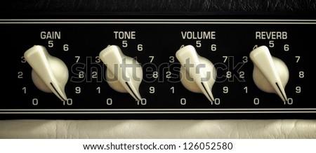 retro guitar amplifier control panel, maximum position, close up - stock photo