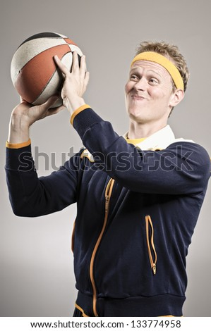 Retro Gym Coach Giving A Basketball Lesson - stock photo