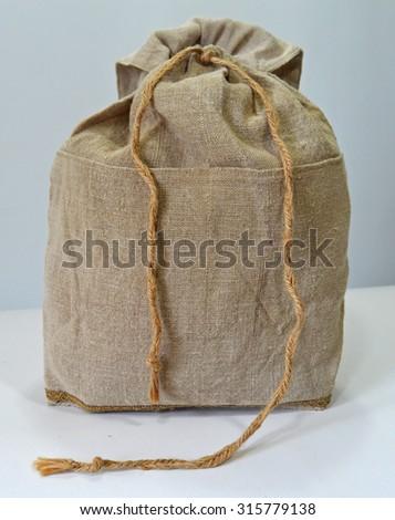 Retro handmade natural flax backpack - stock photo