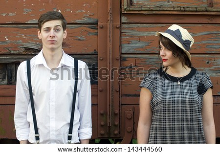 Retro hip hipster romantic love couple funny face vintage industrial setting - stock photo