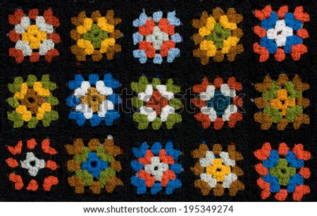 Retro homemade crochet blanket made from Granny Squares - stock photo