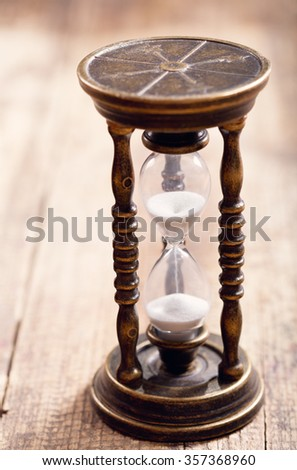 retro hourglass on wooden table