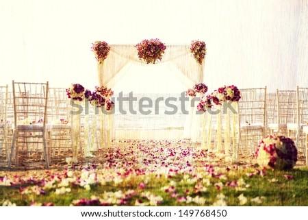 Retro image of Wedding setting on the beach. - stock photo