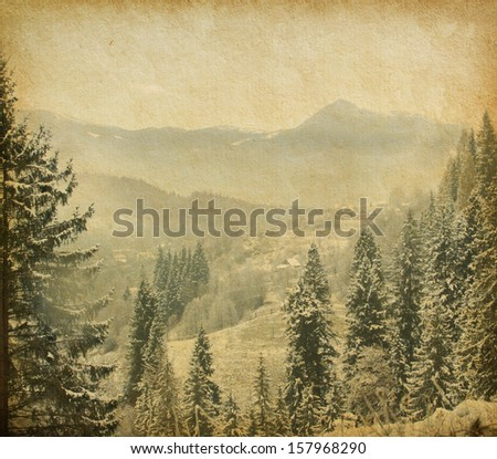 Retro image of winter landscape in the carpathians mountains. vintage paper . - stock photo