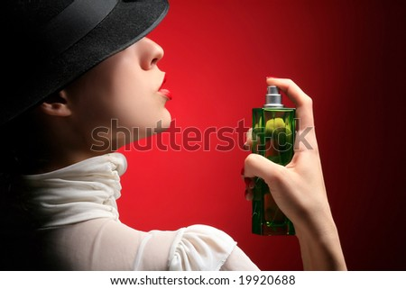 retro lady with perfume on the red - stock photo