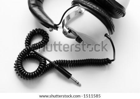 retro large headphones in black and white - stock photo