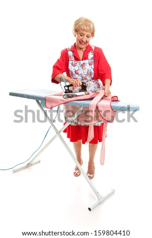 Retro looking senior lady does the ironing.  Full Body isolated on white.