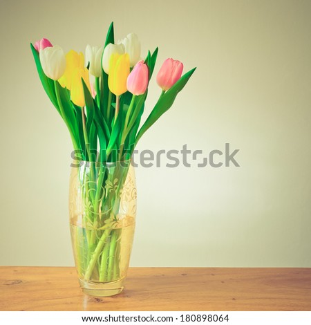 Retro looking tulips filtered - stock photo
