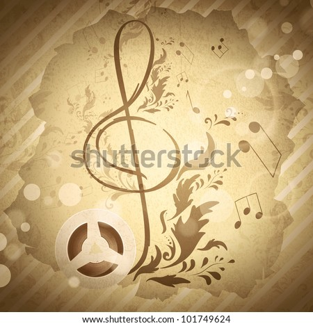 retro magnetic tape with treble clef over abstract floral grunge background - stock photo