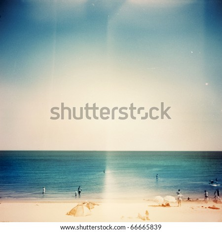 Retro medium format photo. Sunny day on the beach. Grain, blur added as vintage effect. - stock photo
