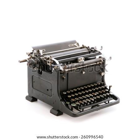 Retro metal typewriter isolated on white background. Studio shot - stock photo