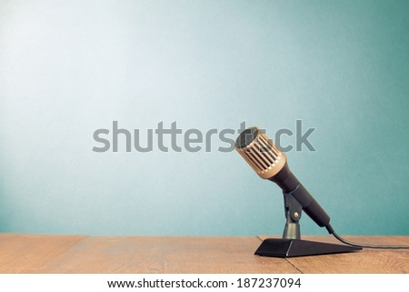 Retro microphone front gradient background - stock photo
