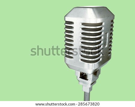 Retro microphone - isolated on green background