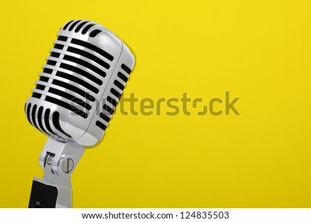 Retro microphone isolated on yellow background
