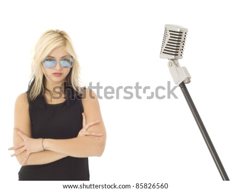 Retro microphone with singer out of focus in background - stock photo