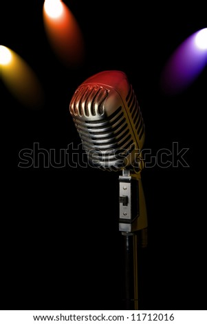 Retro microphone with 3 spotlights - stock photo