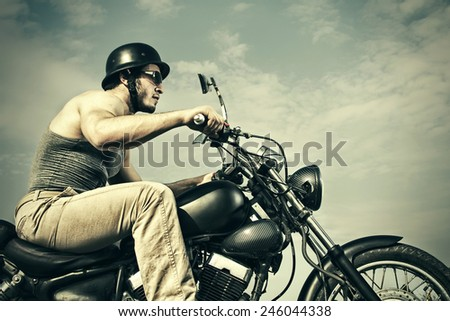 Retro Motorbiker - stock photo