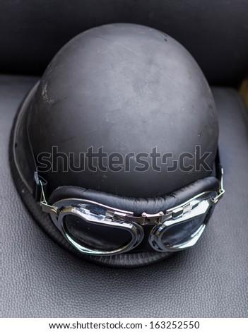 Retro motorcycle helmet with goggles - stock photo
