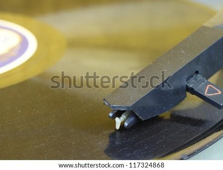 Retro music record plate and tonearm head macro closeup - stock photo