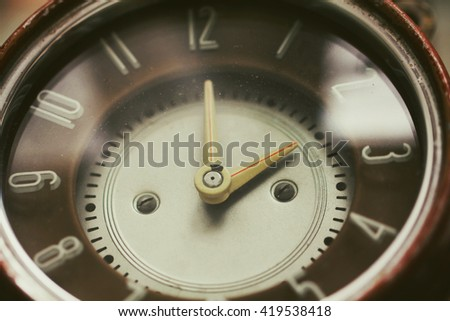 Retro old brown clock in vintage style - stock photo