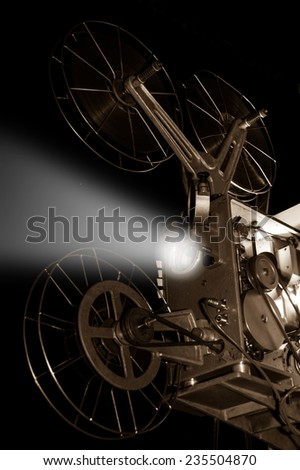 Retro old cinema projector,sepia filtered. - stock photo