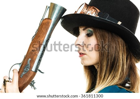Retro old fantasy fashion style. Young pretty woman with vintage pistol isolated on white. - stock photo