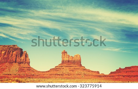 Retro old film style rock formations in Monument Valley, Utah, USA.