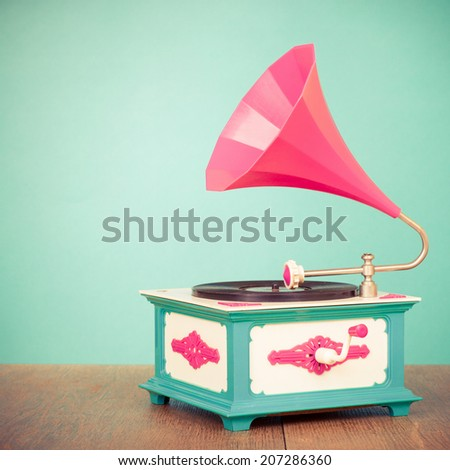 Retro old gramophone radio receiver from the 80s front mint green background - stock photo