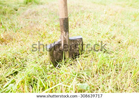 Retro old metal shovel on the ground in the garden