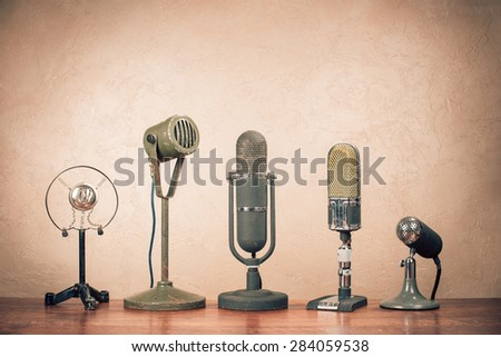 Retro old microphones for press conference. Vintage instagram style filtered photo - stock photo
