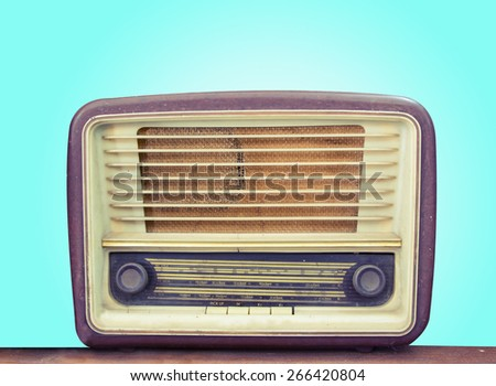 Retro old radio front green background - stock photo