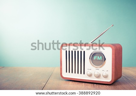 Retro old radio front mint green background. Vintage style filtered photo - stock photo