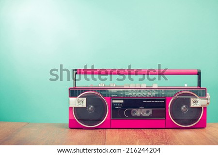 Retro old radio recorder from 80s front mint green wall background - stock photo