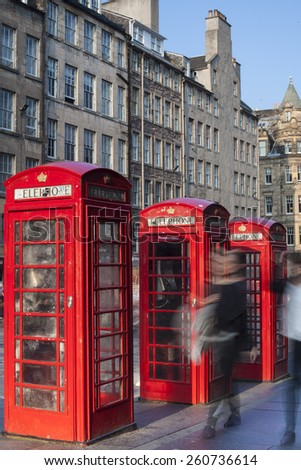 Retro old red telephone booths on Royal mile street in Edinburgh, capital of Scotland, United Kingdom - stock photo