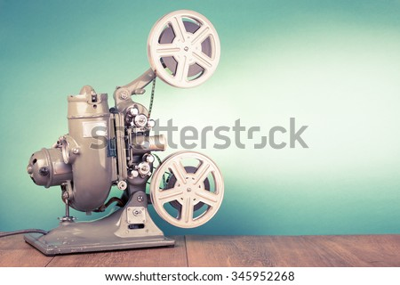 Retro old reel movie projector for cinema. Vintage style filtered photo - stock photo