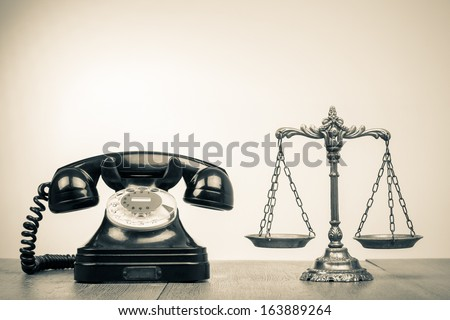 Retro old telephone and scales on wood table sepia photo - stock photo