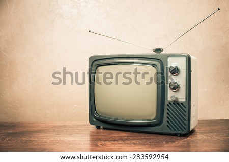 Retro old television from 70s on table. Vintage instagram style filtered photo - stock photo